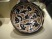 An example of white slip earthenware, with a beautiful design of birds and calligraphy, 10th c.